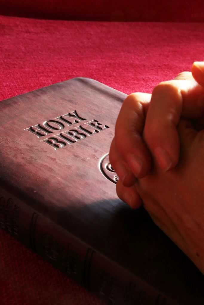 Persons Hands on Holy Bible