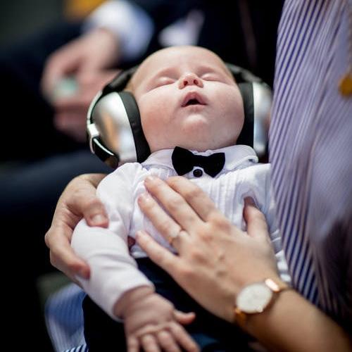 Baby asleep with headphones on