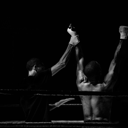 Boxer with hands in air after winning a fight