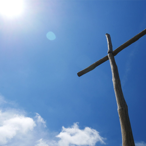 Cross with blue sky behind
