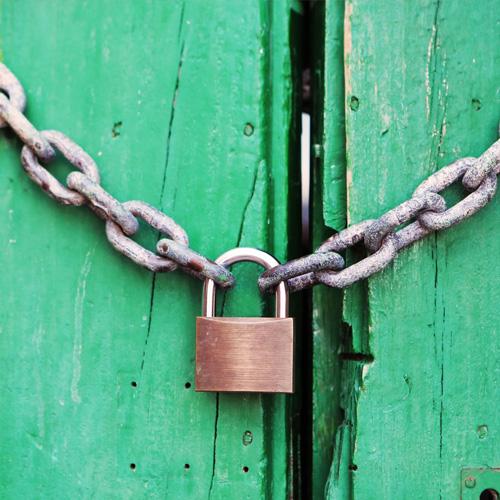 Door locked shut with a chain