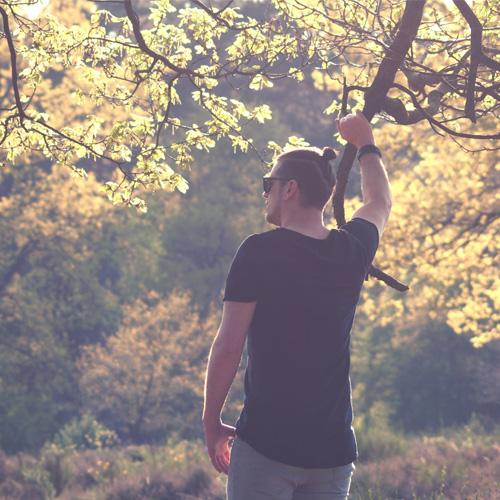 Man Holding Tree Branch